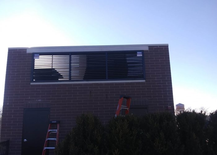 Custom metal louver (aluminum AmeriLouver®) HVAC screen at Royal Oak Ventures